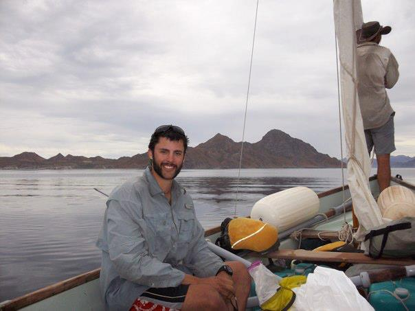 NOLS student sits in a sailboat on a semester in Baja California, Mexico