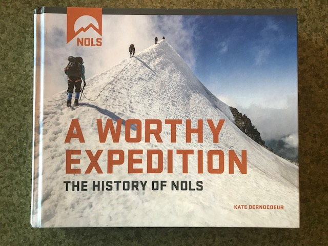 NOLS History Book with snowy mountaineering picture on the cover