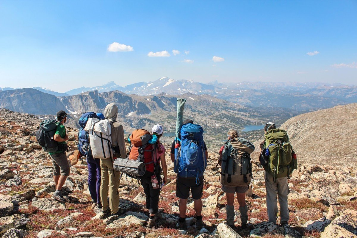 Group backpacking in the Wind River Range pauses high on a ridge