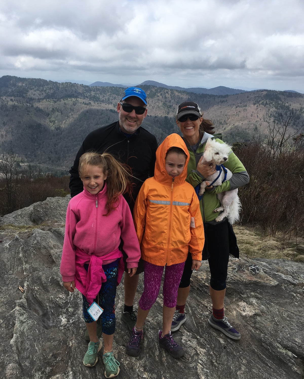 Andrew Bobilya and his family smile while hiking in North Carolina