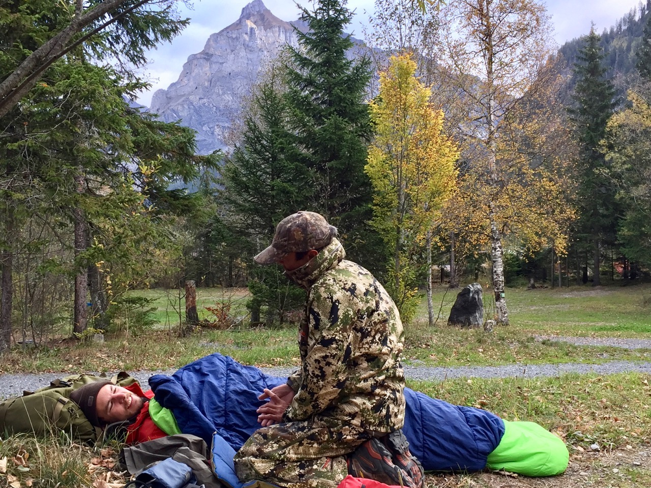 NOLS Wilderness Medicine student practices caring for a patient wrapped in a sleeping bag in the mountains