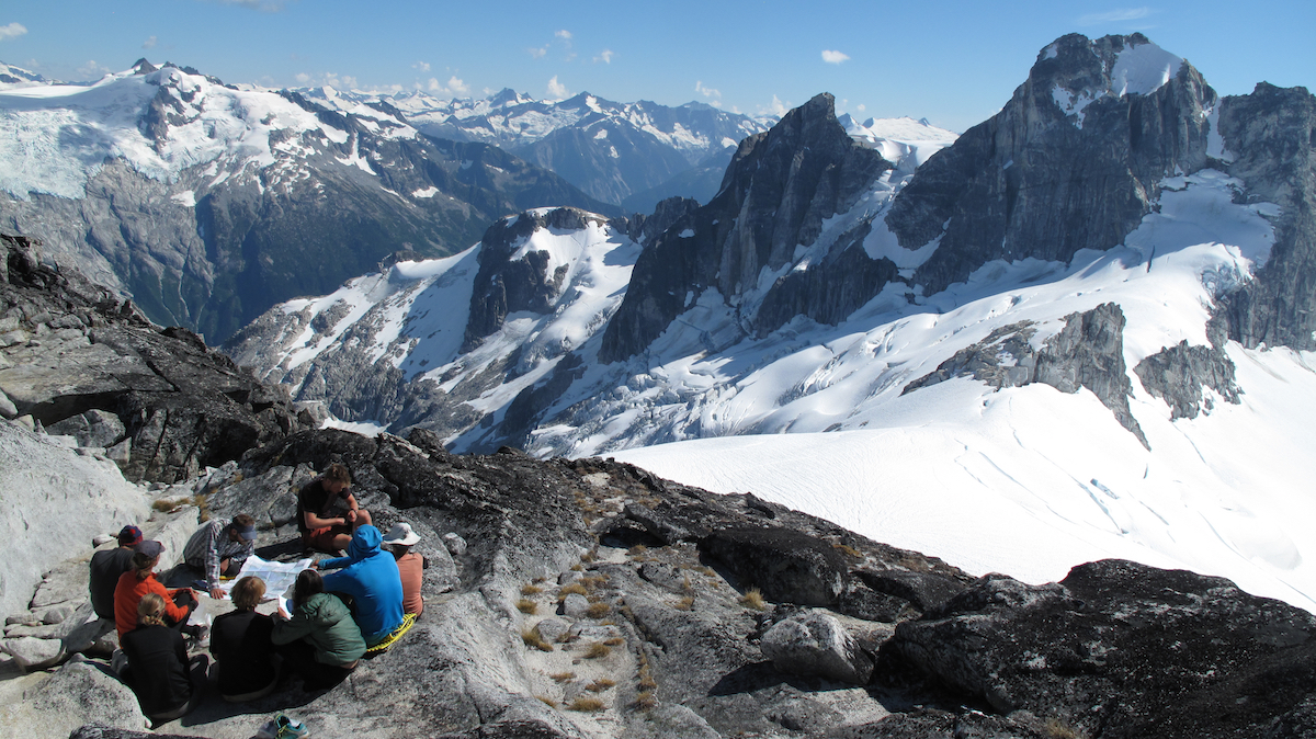 NOLS students circle up for a lesson in the mountains of the Pacific Northwest