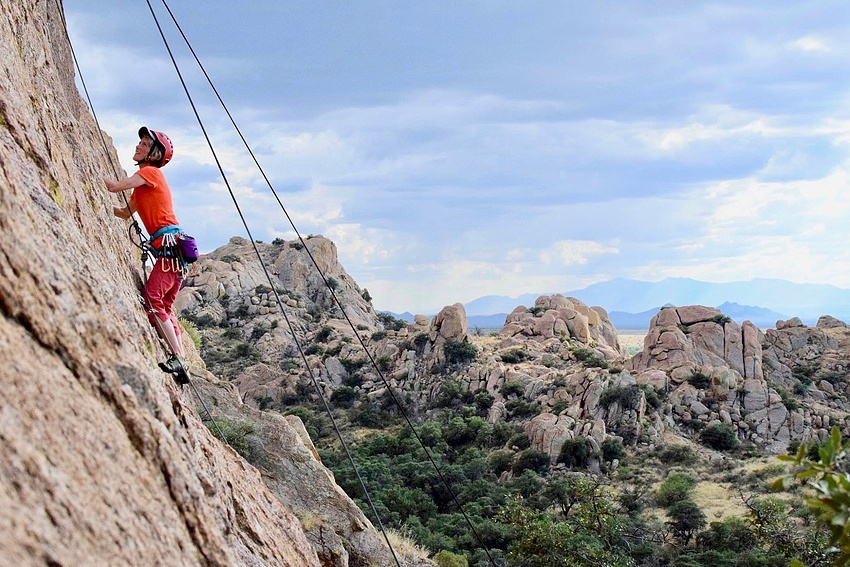 NOLS student mock lead climbs in the Southwest on a women's-only course