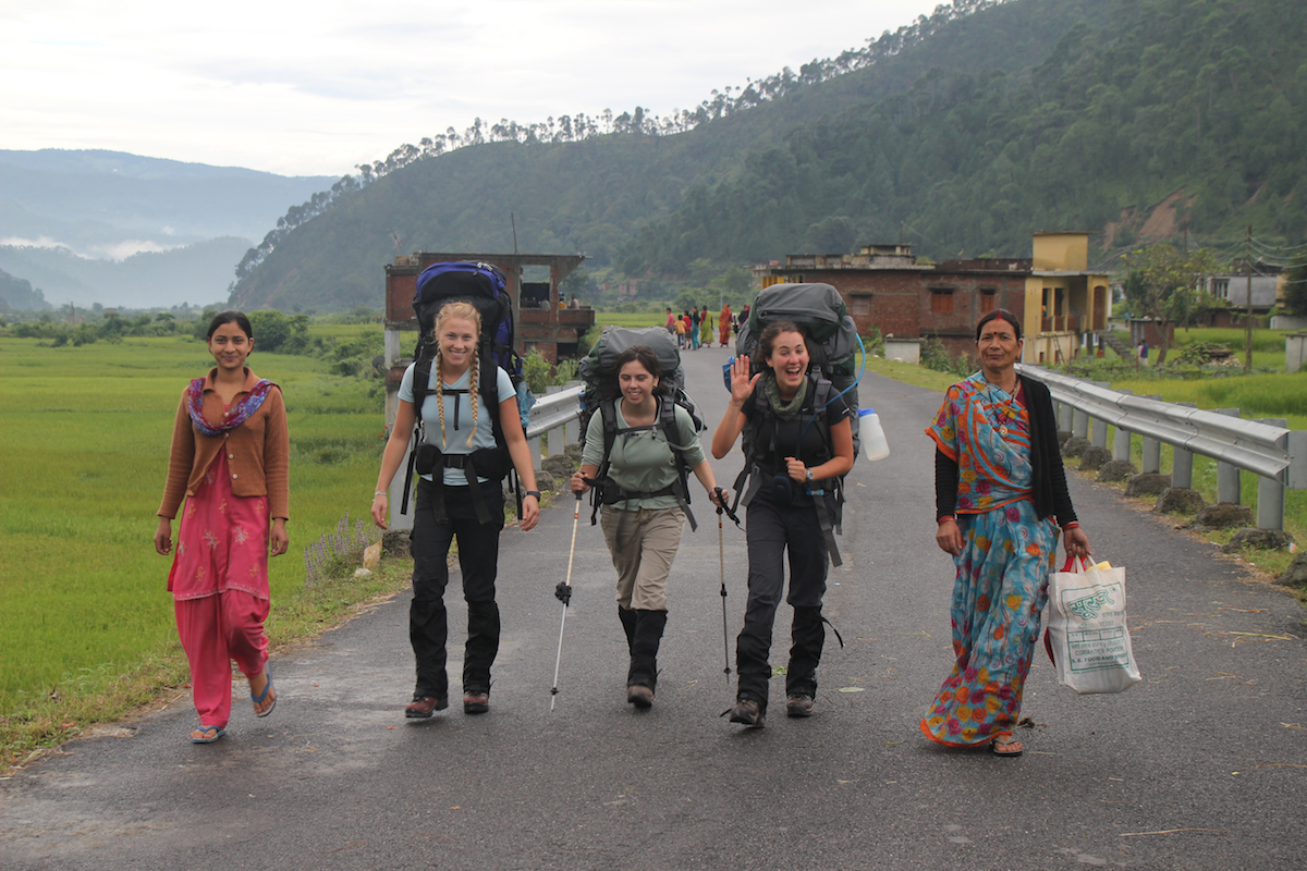NOLS students hike with local women in the Indian Himalaya