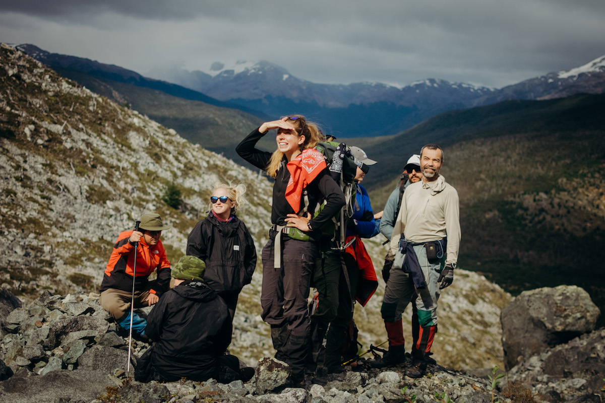 A group of NOLS students pauses while hiking