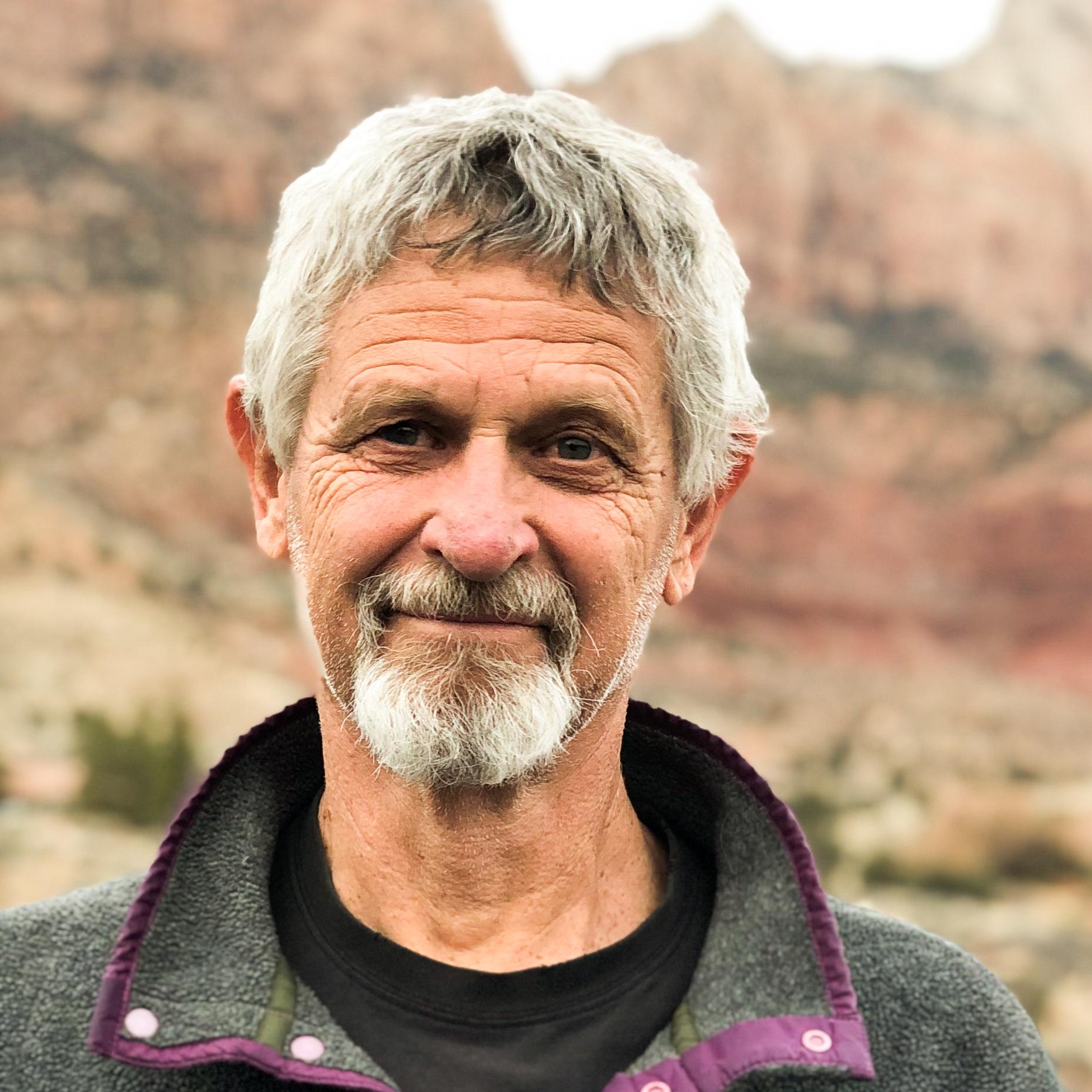 portrait of Randy Aton wearing a grey fleece
