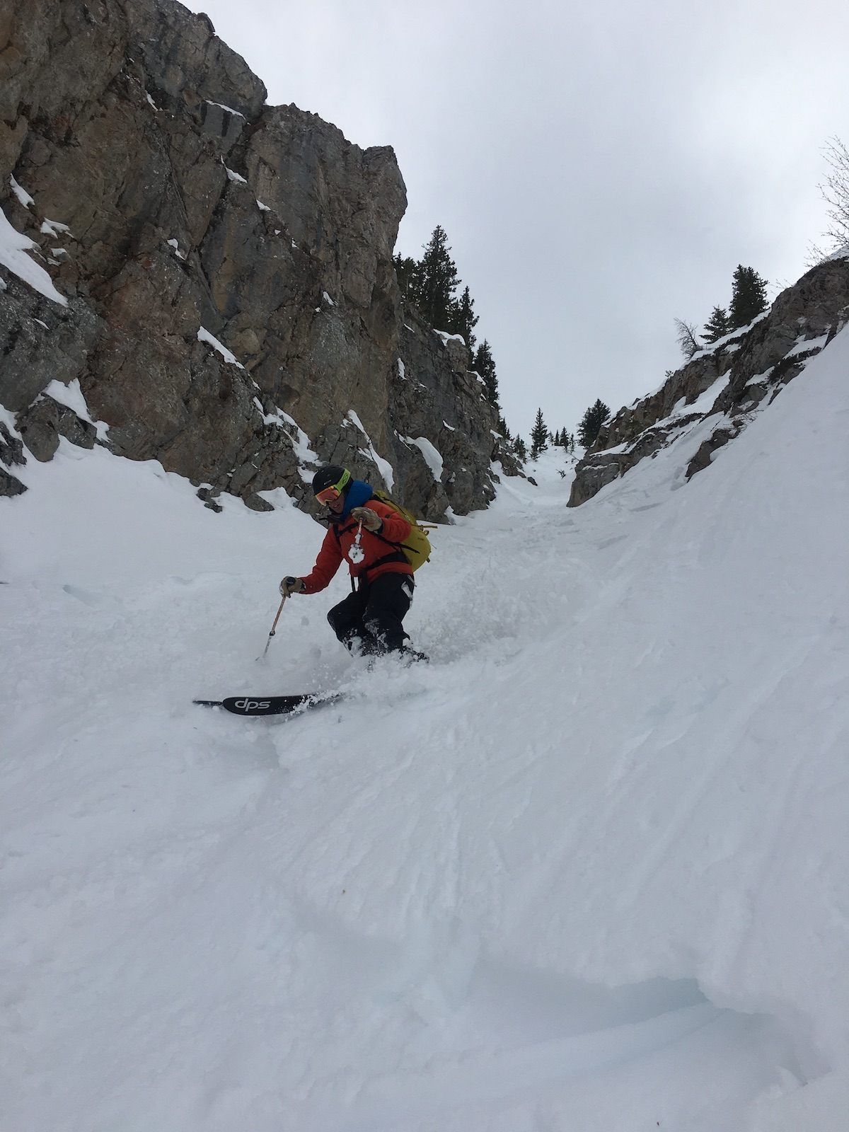 Person skiing down a chute