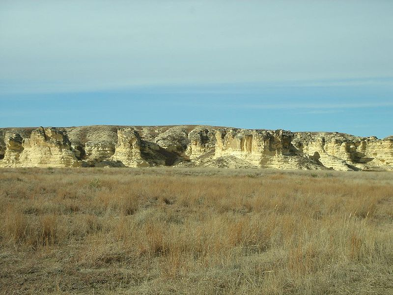 badlands in Kansas with yellow grass and chalk formations