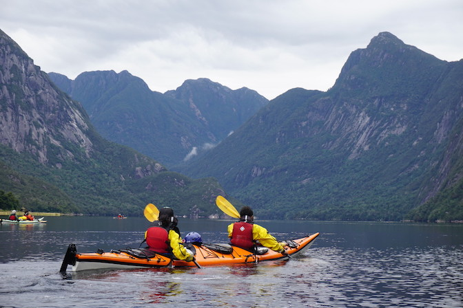 Two people sea kayaking in Alaska