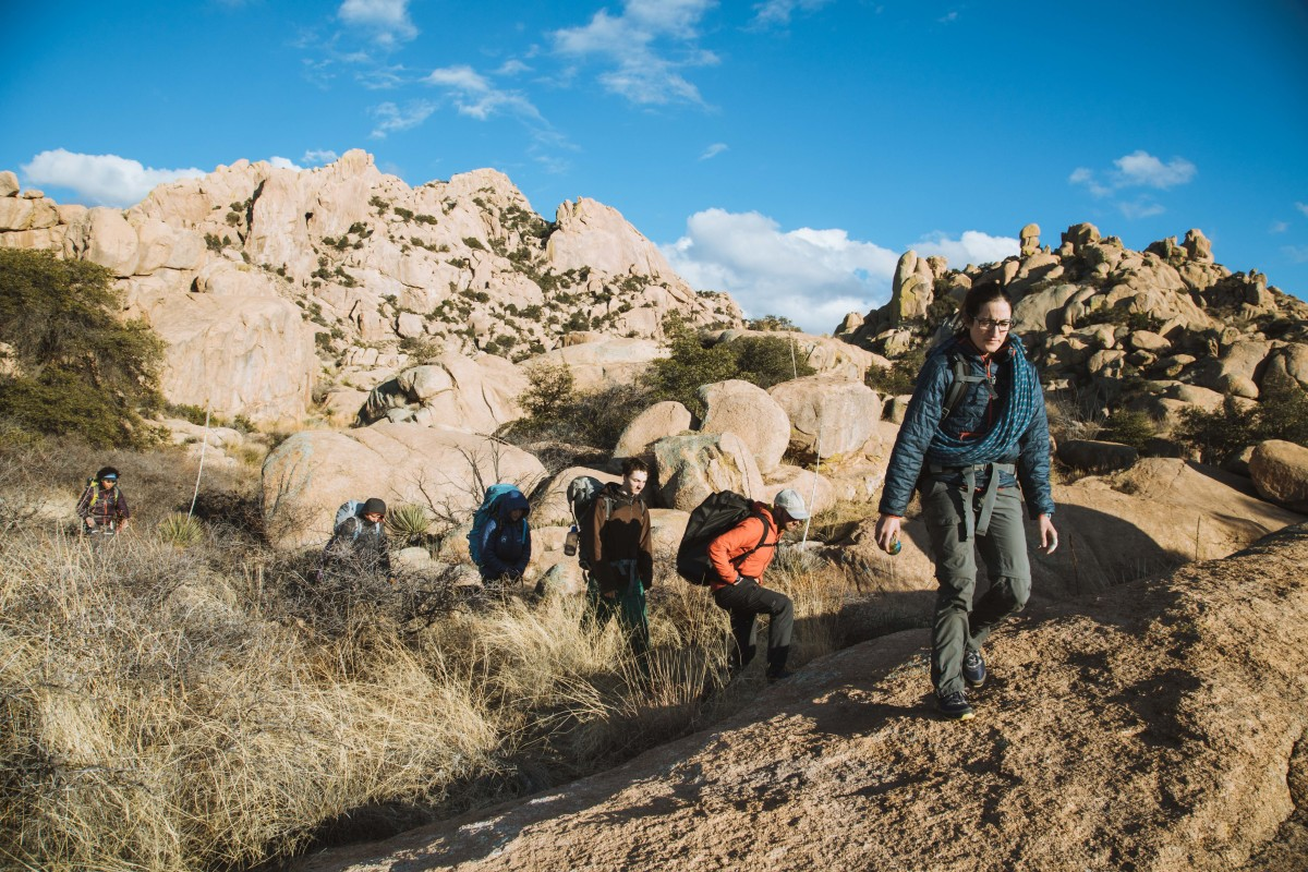 Group of hikers with rock climbing gear in rocky landscap
