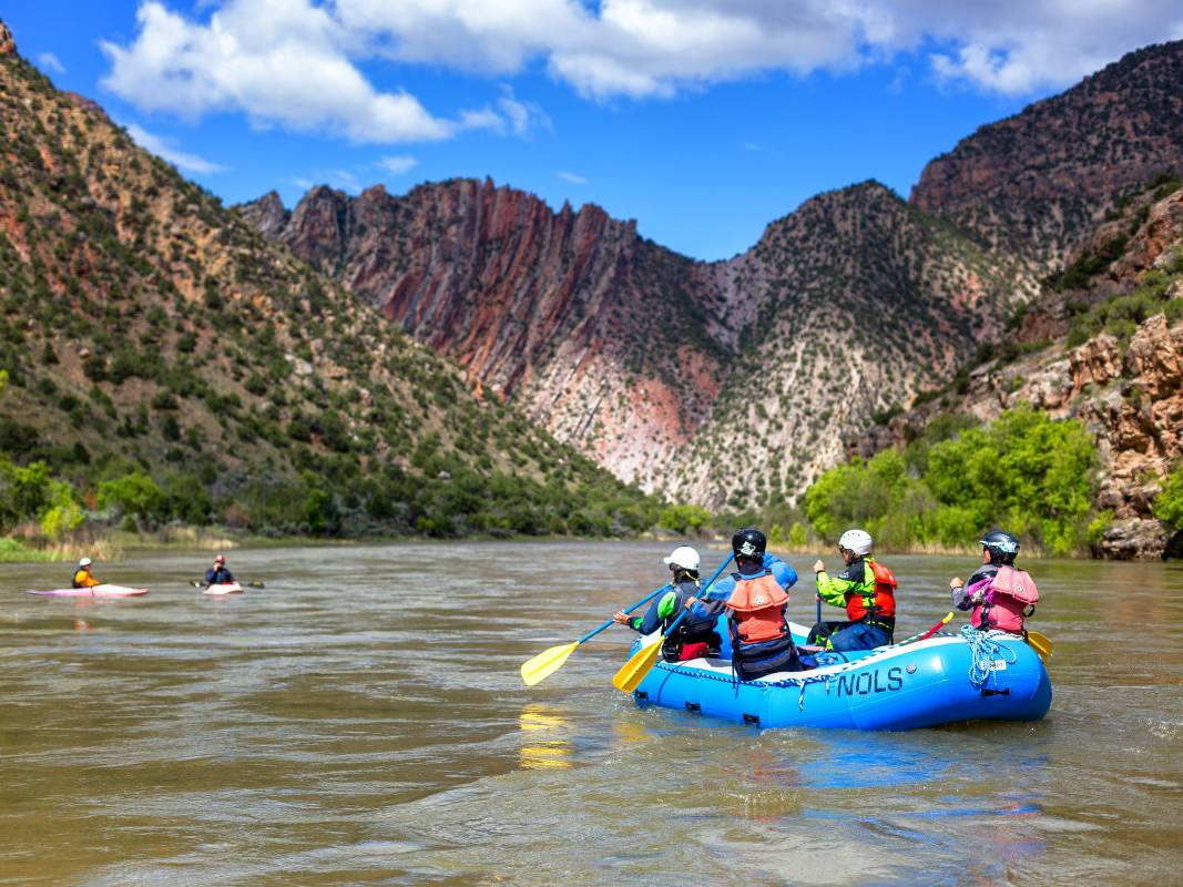 Rafters in an inflatable raft on a desert river