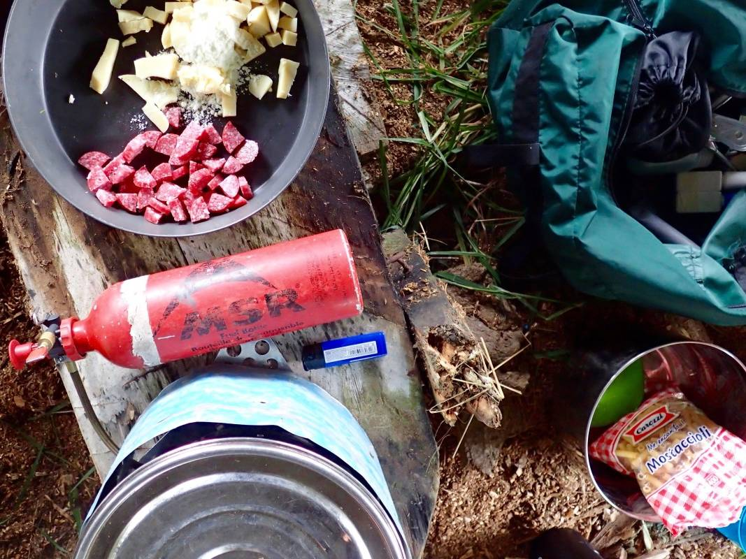 Fry bake with sausage and cheese and a cooking pot