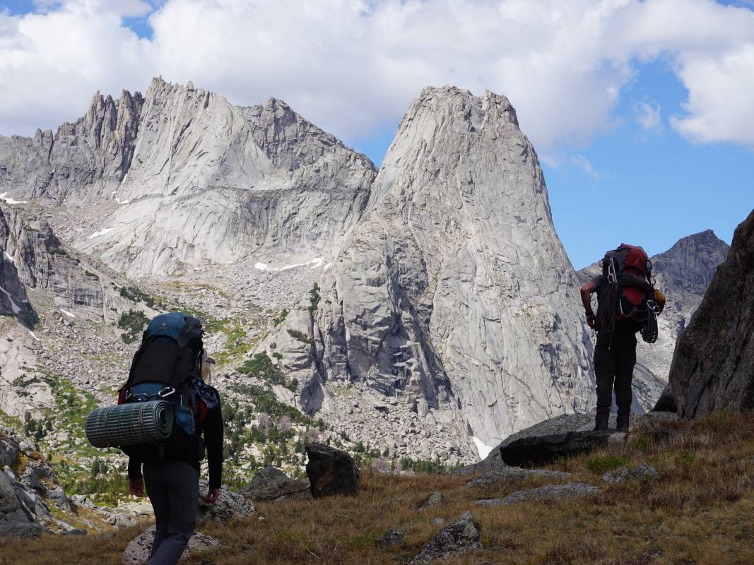 Backpackers hike in front of stunning Pingora Peak in the Wind River Range