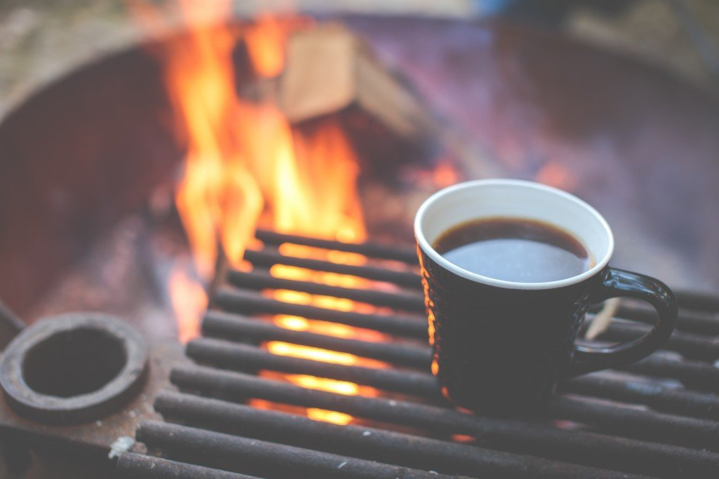 Hot coffee on a grate over a fire