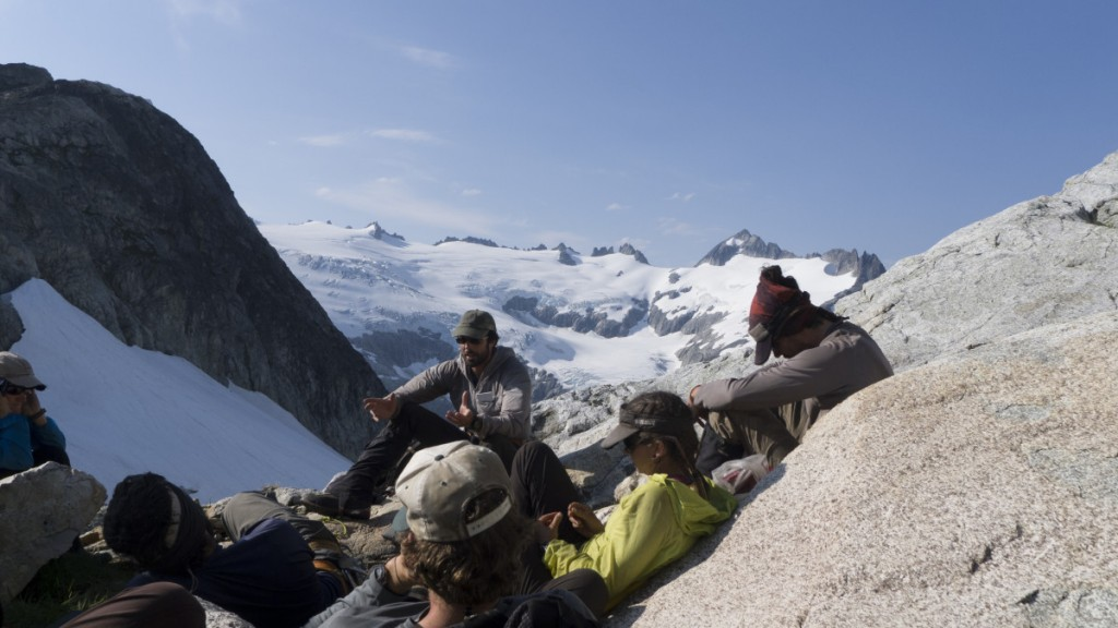 NOLS instructor teaches group of students in the mountains