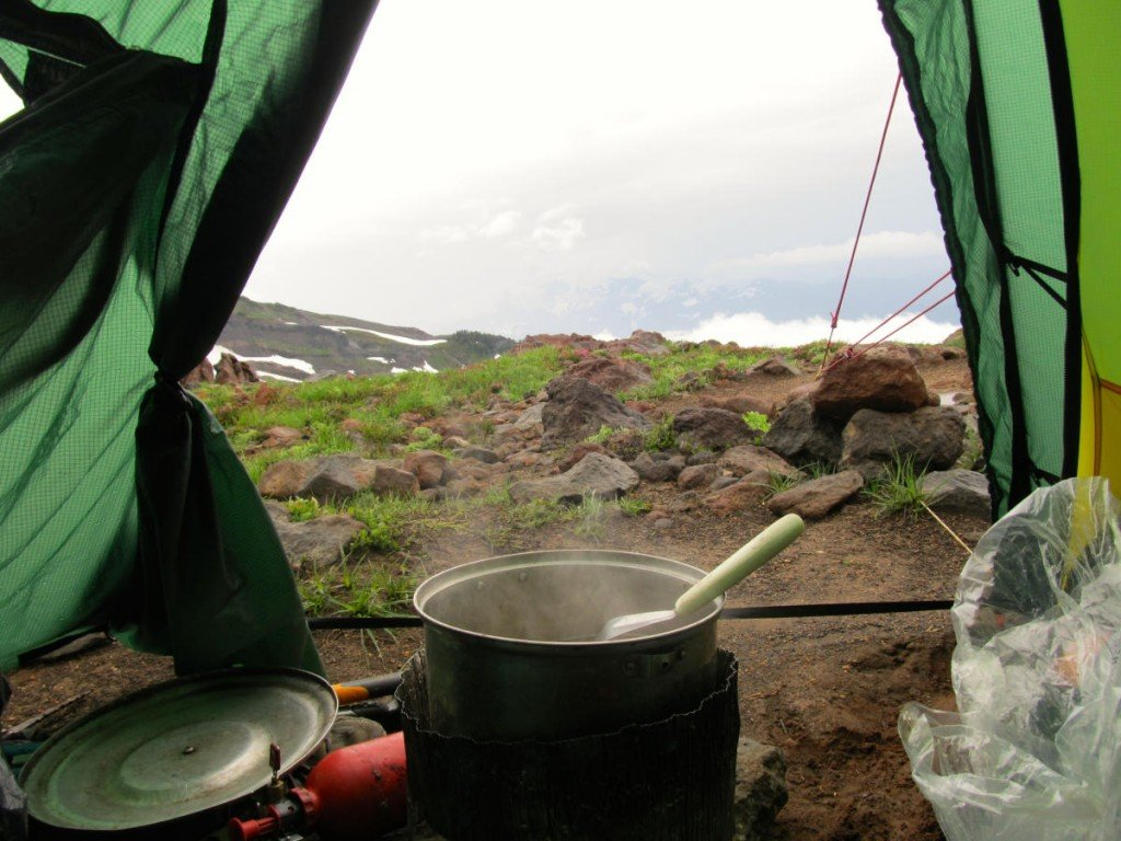 Steaming pot in the door of a tent