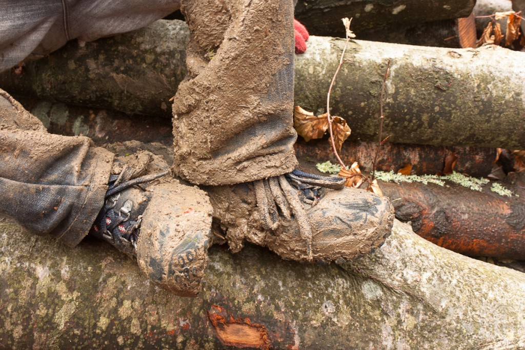 Close up on a muddy pair of boots