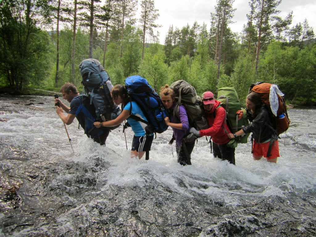 Group crossing a river in a line