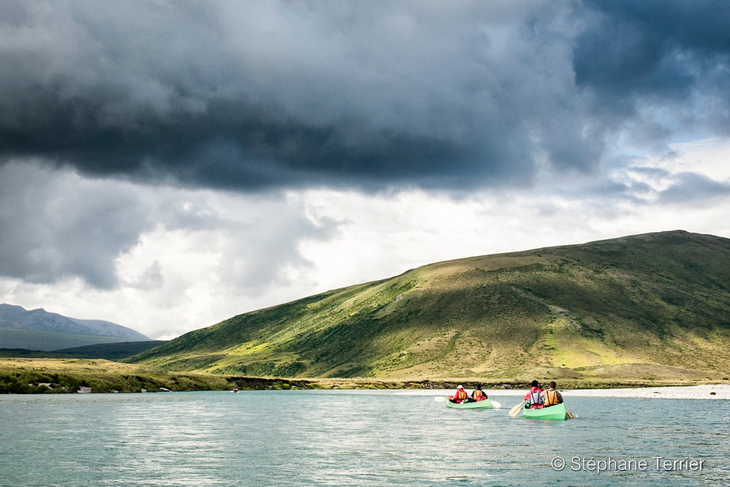 Paddlers canoeing on a remote river