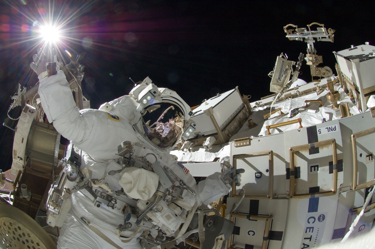 NASA astronaut Sunita Williams performs repairs on the International Space Station during a six-hour spacewalk.