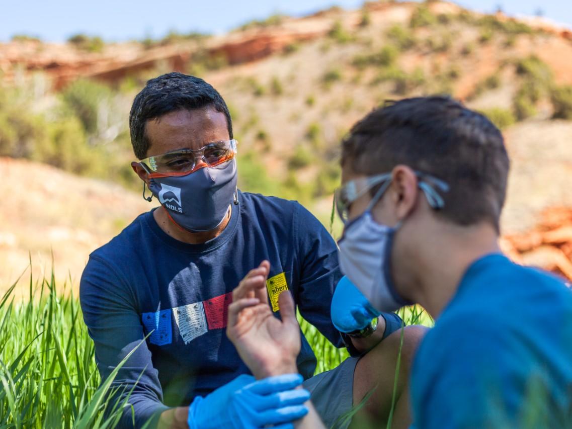 Rescuer checks patient pulse in a practice scenario