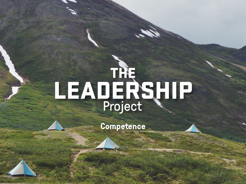 Text reading The Leadership Project: Competence overlays 4 pyramid shaped tents in a mountain meadow