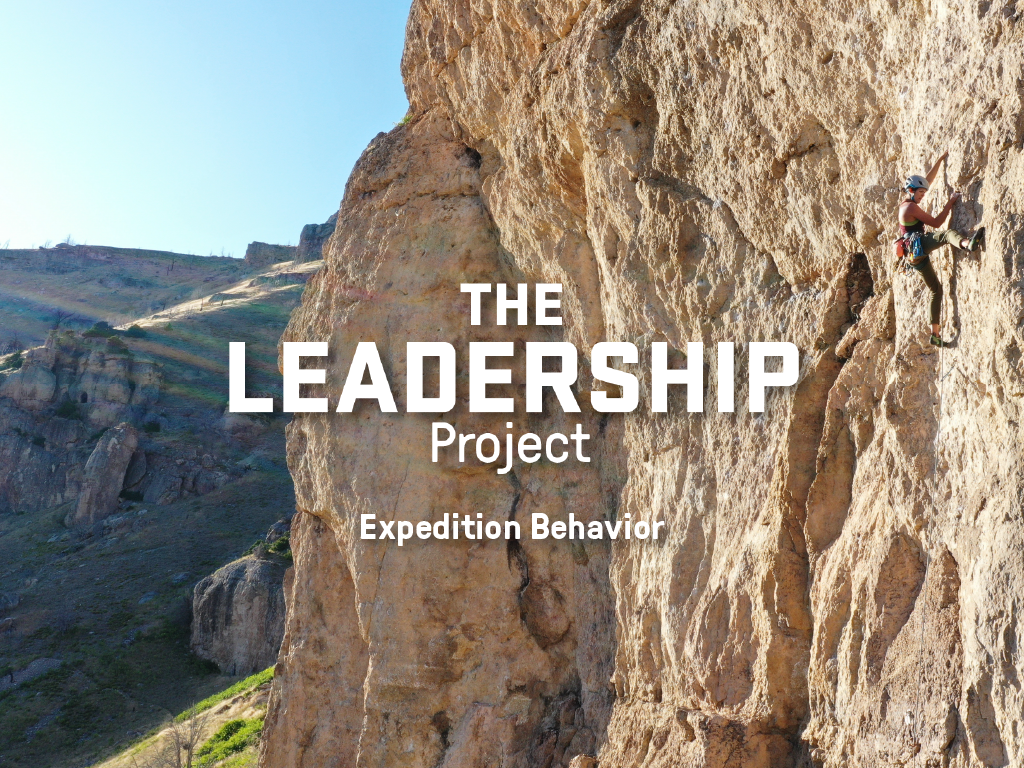 Text overlay of The Leadership Project: Expedition Behavior on a photo of a woman rock climbing