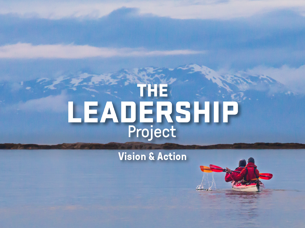 Text overlay of The Leadership Project: Vision & Action on an image of a tandem kayak with snowy mountains