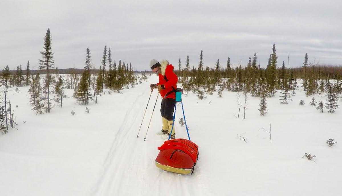 Pete Ripmaster pulls a sled across a snowy Alaskan landscape